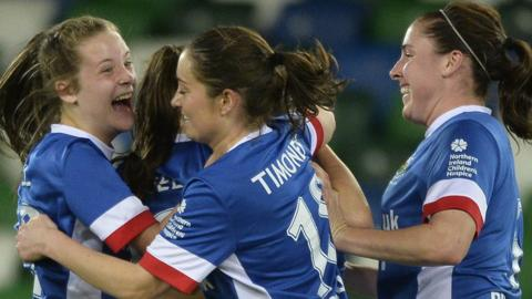 Linfield celebrate after Abbie Magee's winning goal in the Women's Challenge Cup final against Cliftonville - a victory which saw the Blues complete a league and cup double