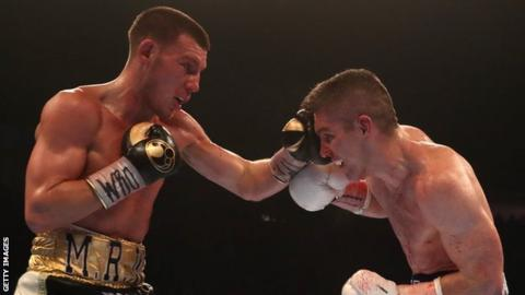 Liam Williams (left) punches Liam Smith