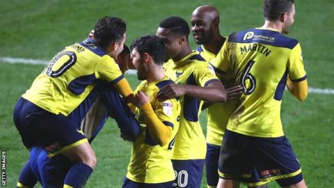 Oxford celebrate their Checkatrade Trophy win over Charlton on Tuesday