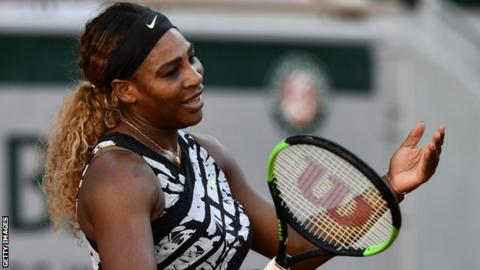 Serena Williams holds her hands up in frustration