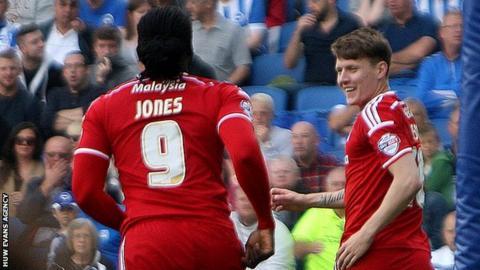 Joe Mason (R) celebrates his goal with Kenwyne Jones