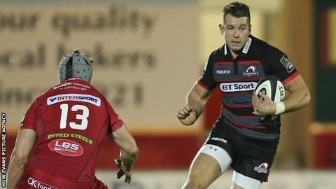 Jason Harries of Edinburgh takes on Scarlets defender Jonathan Davies