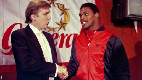 USFL team New Jersey Generals owner Donald Trump, shakes hands with star player Herschel Walker