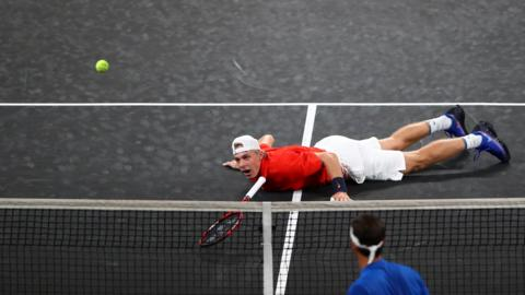 GENEVA, SWITZERLAND - SEPTEMBER 20: Denis Shapovalov, playing partner of Jack Sock of Team World reacts after diving to play a shot during their doubles match against Roger Federer and Alexander Zverev of Team Europe during Day One of the Laver Cup 2019 at Palexpo on September 20, 2019 in Geneva, Switzerland. The Laver Cup will see six players from the rest of the World competing against their counterparts from Europe. Team World is captained by John McEnroe and Team Europe is captained by Bjorn Borg. The tournament runs from September 20-22. (Photo by Clive Brunskill/Getty Images for Laver Cup)