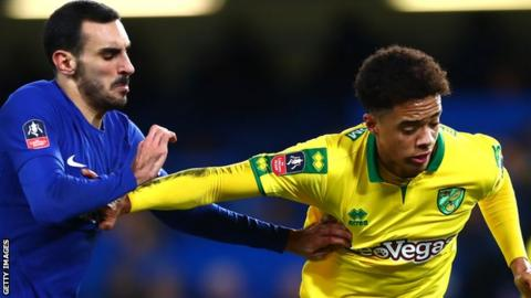 Chelsea defender Davide Zappacosta challenges Norwich City's Jamal Lewis in the FA Cup replay at Stamford Bridge