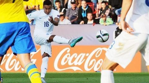 Jesse Lingard scores for England