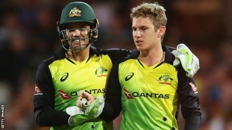 Adam Zampa (right) celebrates a wicket for Australia's T20 side