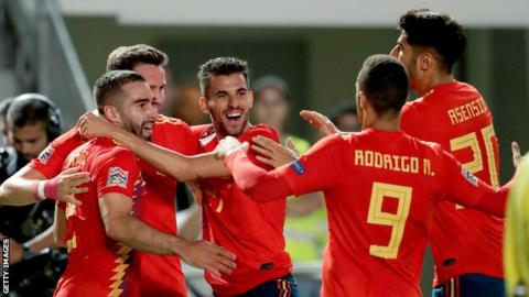Spain players celebrate Saul Niguez's opening goal