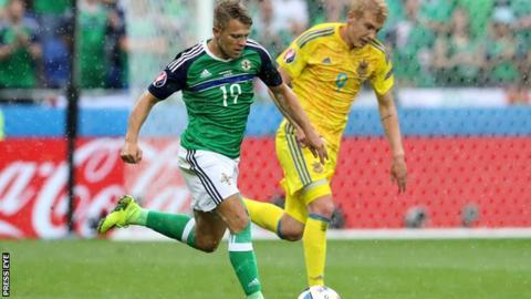 Jamie Ward battles with Ukraine's Viktro Kovalenko during Northern Ireland's win in Lyon on Thursday
