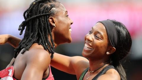 Shelly-Ann Fraser-Pryce (right) is congratulated