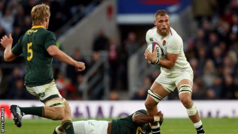 Brad Shields grapples for the ball against South Africa