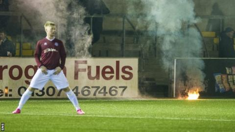 A flare on the pitch as Forfar Athletic face Linlithgow Rose