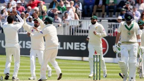 Pakistan celebrate as Ireland batsman Andrew Balbirnie walks off after his dismissal