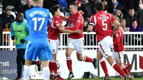 Wrexham's Scott Quigley celebrates opening the scoring in his side's win at Hartlepool