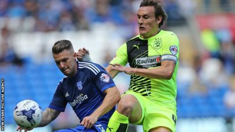 Cardiff's Anthony Pilkington shields the ball from Huddersfield's Dean Whitehead