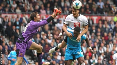 Chris Martin heads his second goal in Derby County's 4-2 win over Wolves