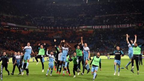 Lazio celebrate after their 1-0 win at the San Siro