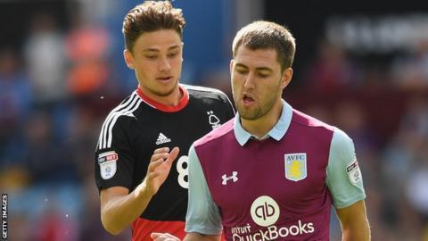 Matty Cash of Nottingham Forest and Aston Villa's Gary Gardner