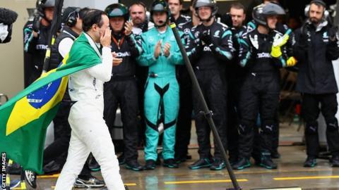 The Mercedes team applaud an emotional Massa as he walks down the pit lane