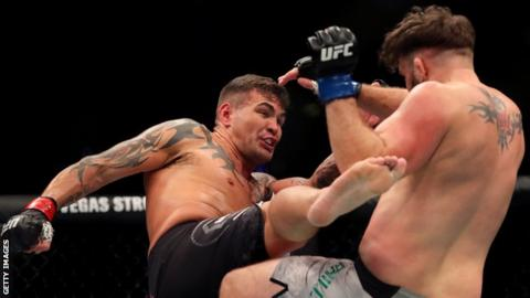 Jack Marshman kicks John Phillips during the middleweight bout at UFC London in March 2019