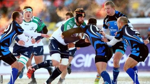 Connacht's Aly Muldowney is tackled by Ramil Gaisin and David Kacharava in Russia