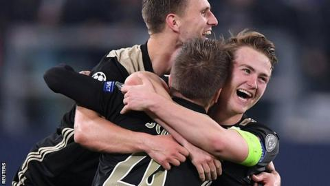 Ajax players celebrate their victory over Juventus