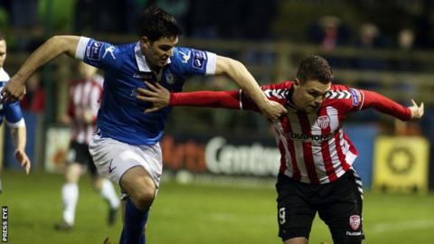 Finn Harps Packie Mailey battles with Derry debutant Jordan Allan