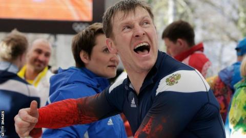 Bobsledder Aleksandr Zubkov celebrates winning a gold medal at Sochi 2014