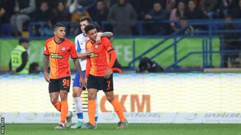 Taison in tears on the pitch