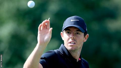 Rory McIlroy is about to catch a ball during his practice round in Atlanta on Wednesday