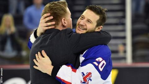 Peter Russell congratulates GB player Jonathan Phillips