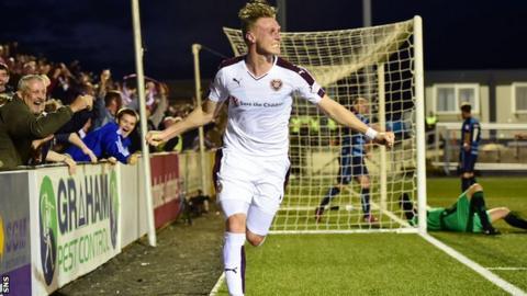Kevin McHattie celebrates scoring for Hearts