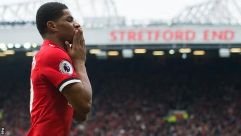 Marcus Rashford celebrates scoring for Manchester United against Liverpool