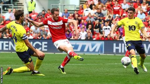 Bristol City's Marley Watkins scores against Blackburn
