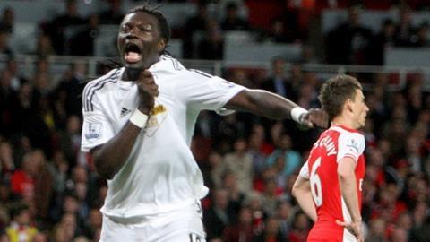 Bafetimbi Gomis celebrates scoring for Swansea against Arsenal