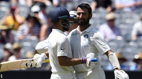 Cheteshwar Pujara and Virat Kohli celebrate