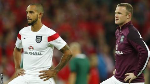 Theo Walcott and Wayne Rooney