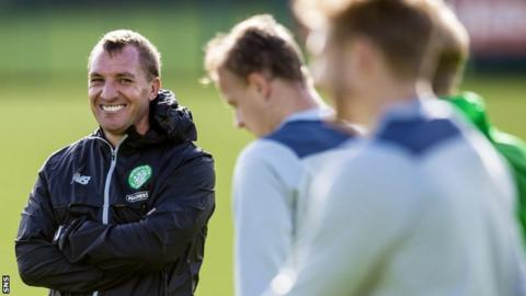 Celtic manager Brendan Rodgers enjoys a laugh at training
