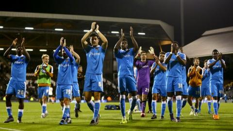 Wolves players celebrate victory at Fulham - their first away win since the first day of the season at Blackburn