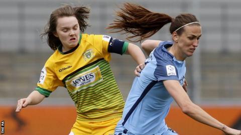 Ellie Curson challenges Manchester City's Jill Scott for the ball
