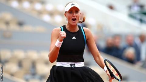 Mladenovic makes a fist in celebration