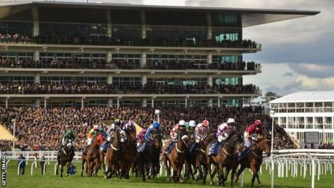 A general view of the field racing during the 2017 Gold Cup in front of the stands at Cheltenham racecourse