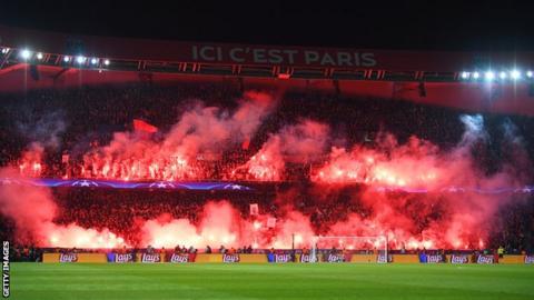Paris St-Germain fans light flares