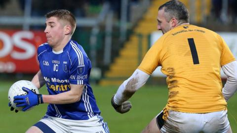 Scotstown forward Orin Heaphy attempts to evade Crossmaglen goalkeeper Paul Hearty in the Senior final at the Athletic Grounds