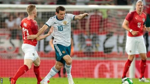 Austria's Florian Kainz and Russia's Alan Dzagoev in action during the international friendly