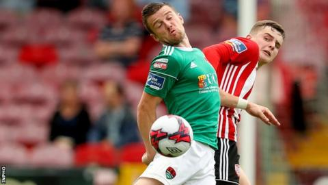 Cork's Steven Beattie battles with Derry's Ronan Hale in the Premier Division in July