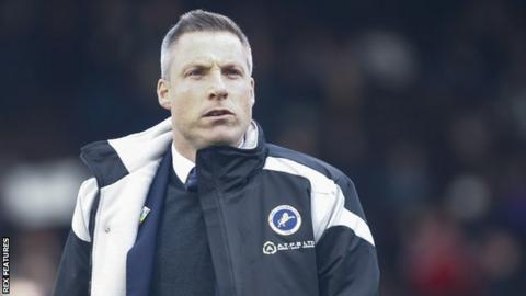Millwall manager Neil Harris watches on from the sidelines