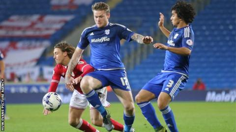 Cardiff's Aron Gunnarson (centre) and Fabio (right) challenge Bristol City's Luke Freeman (left)