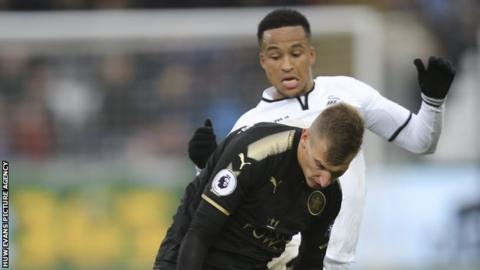 Swansea defender Martin Olsson challenges Leicester's Marc Albrighton during the Foxes' 2-1 win