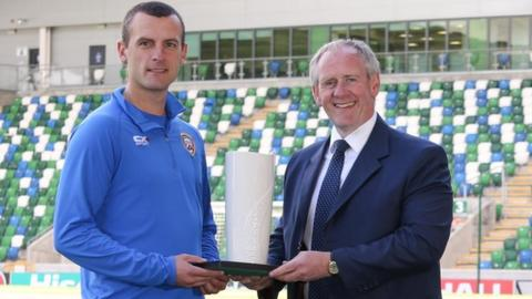 Oran Kearney receives his August manager of the month from Paul McLean